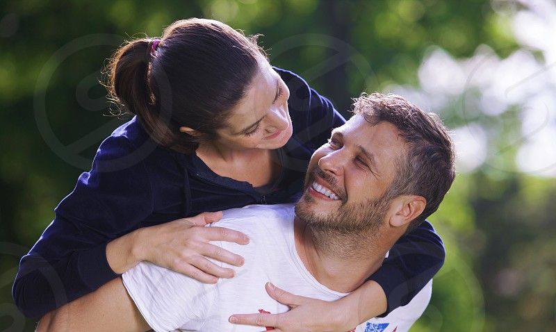 Couple in love she is on his back photo