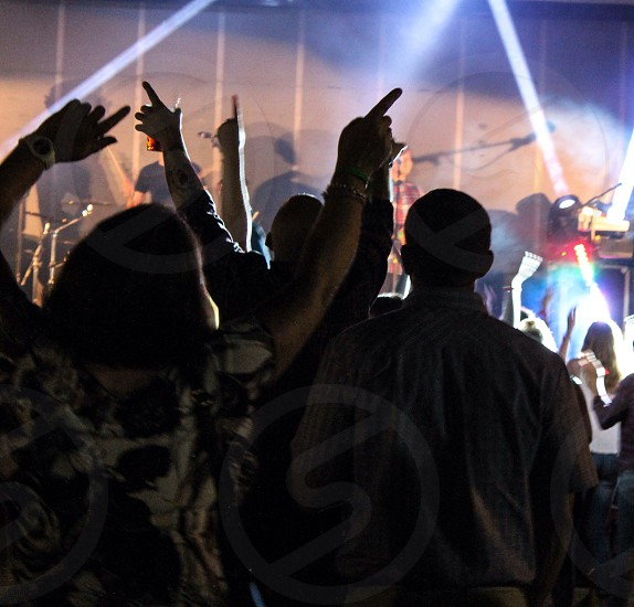 Arms in the air at a concert photo