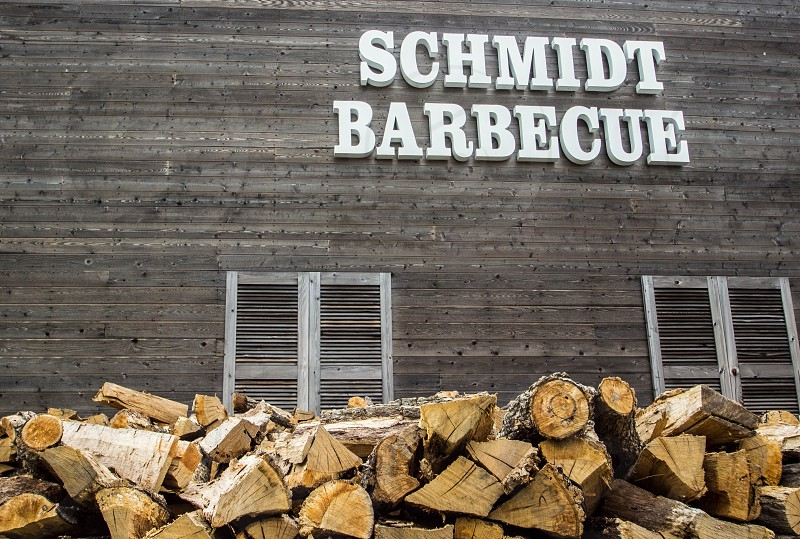 brown wooden logs in front of schmidt barbecue house photo