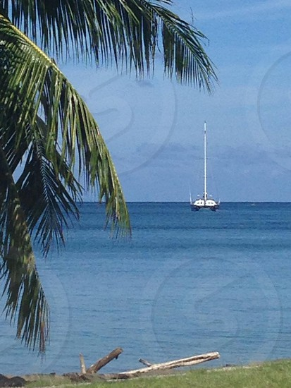 white ship on body of water under blue and white sunny sky during daytime \ photo