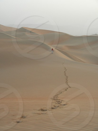person on desert during daytime photo