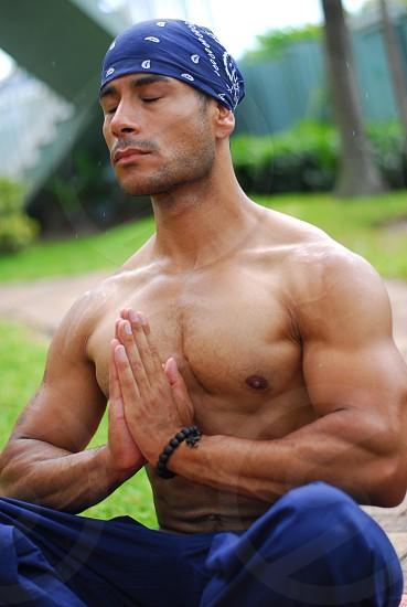 Man meditating outdoors photo