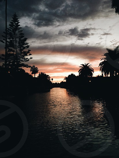 Rowing on the Venice Canals at sunset photo