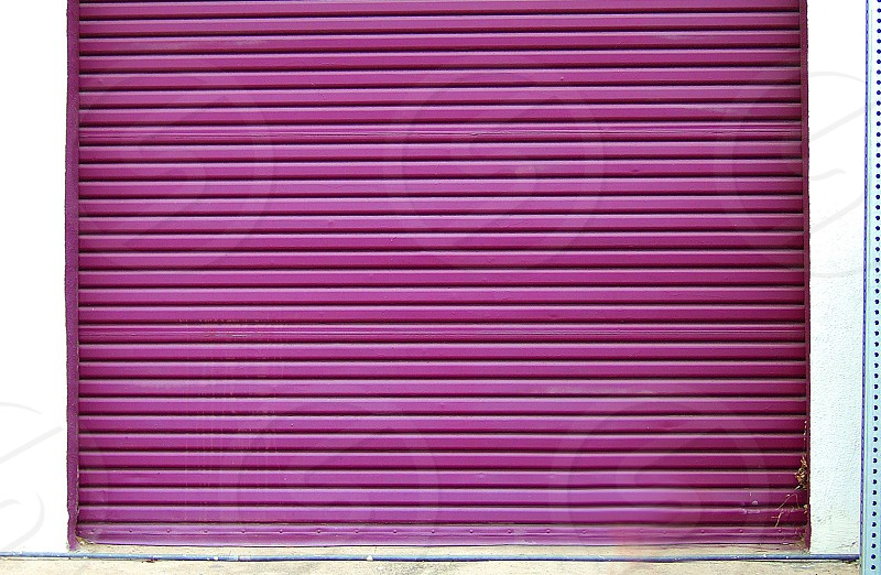 Magenta industrial garage door. photo