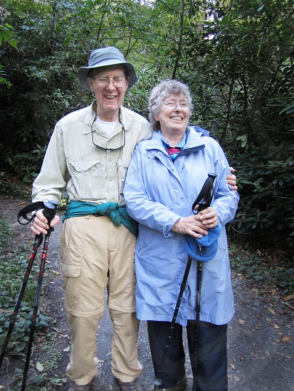 Older Elderly Couple pleased at the end of a mountain hike.   photo