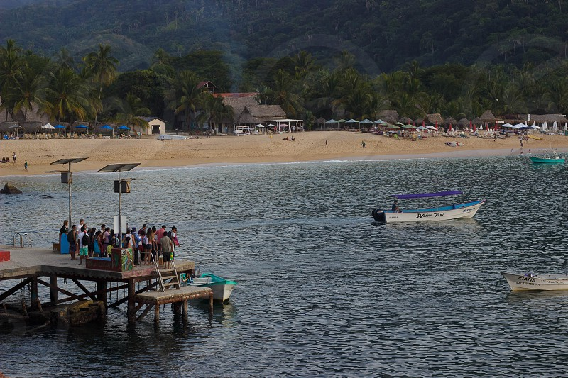 THIS IS THE PIER IN YELAPA BEACH. IN THE BACKGROUND ARE PART OF THE BEACH AND THE RESTAURANTS. THE AQUATIC TAXIS ARRIVE AT THE PIER. WHICH TAKE YOU TO OTHER NEARBY BEACHES photo