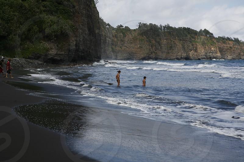 brave adventure explore vacation wanderlust ocean beach Hawaii travel swim woman swimming waves surf  photo