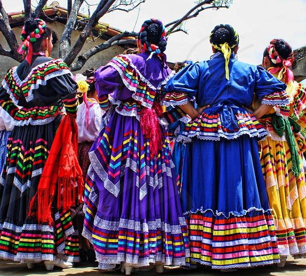 Folklorico dances in colorful dresses. photo