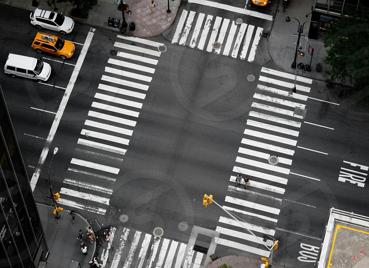 aerial cross road new york taxi street light yellow white black city urban photo