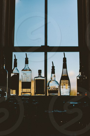 5 o'clock light. Bottles on display. Bar setting. photo