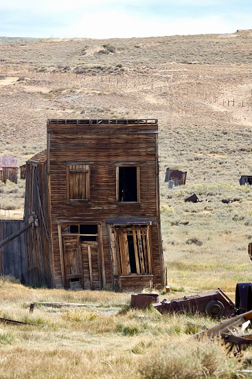 Bodie Mono County California ghost town building home heritage historic gold rush settlers pioneers architecture weathered wood house two story falling down rickety desert Wild West mining town mining fortune hunters 1800 dusty Sierra Nevada desert  photo