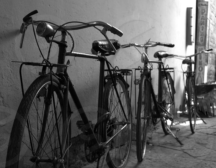 monochrome black and white bicycles bikes street city close up old bikes photo