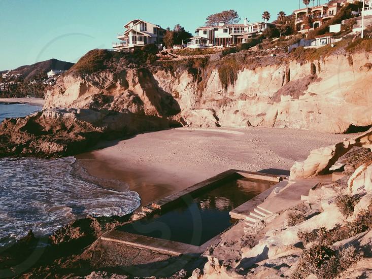 sea shore and white resort photo