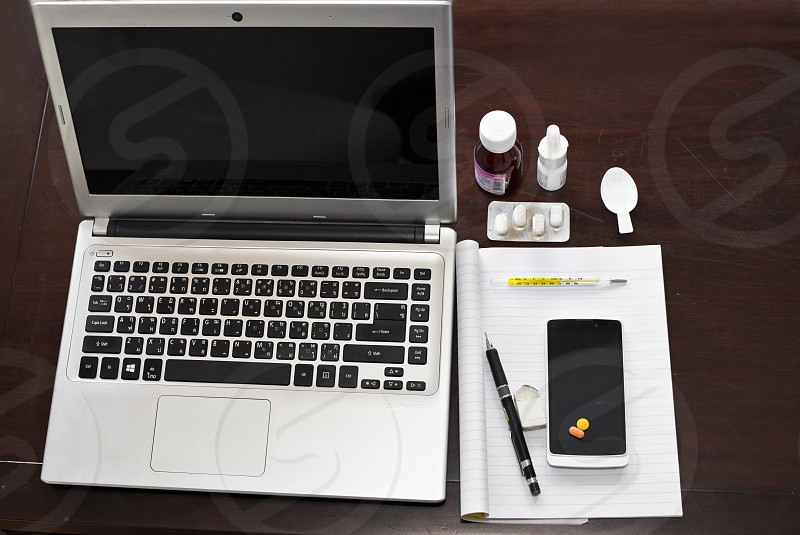Still  life workspace of a sick person working photo