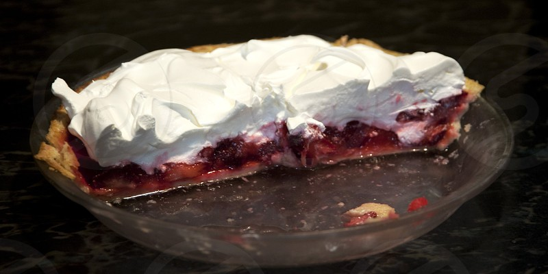 Strawberry pie with whipped cream topping half pie in glass pan photo