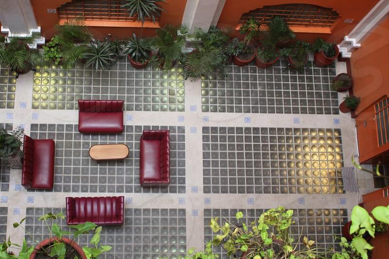 Building. Interior. Different angle. Top view. Orange. Plants.  photo