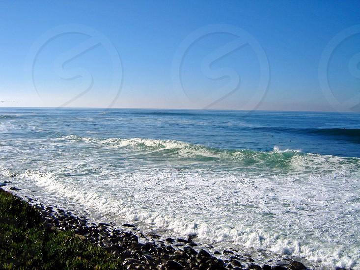 Rocks waves and ocean on the San Diego coast. photo