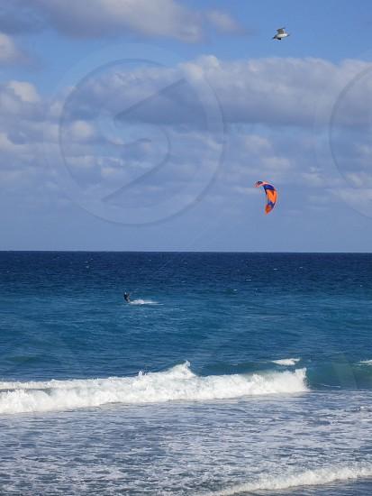Kite surfing on Atlantic Ocean gull waves photo