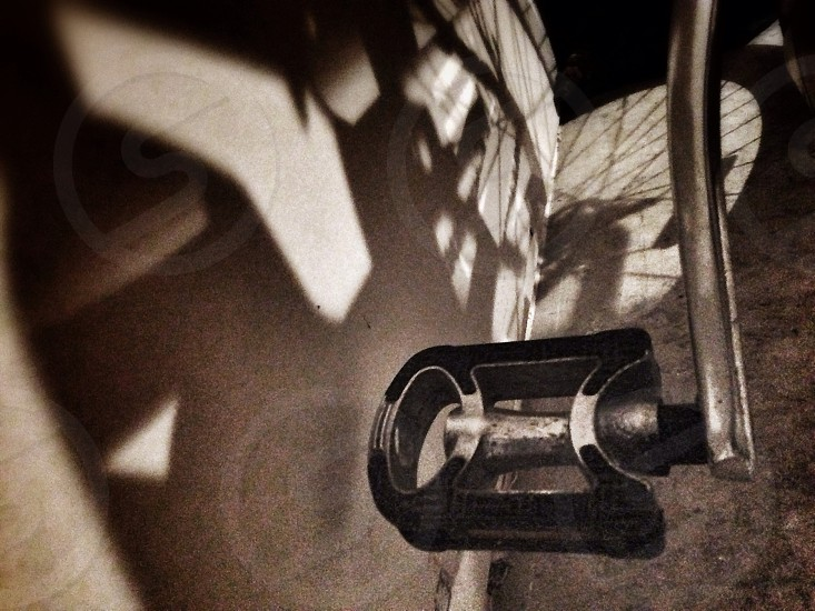 gray and black bicycle pedal photo