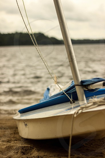 Sunfish sailboat lake water beach sail get out  photo