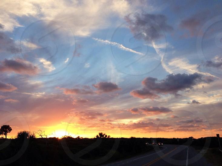 orange sunset touching gray clouds photo