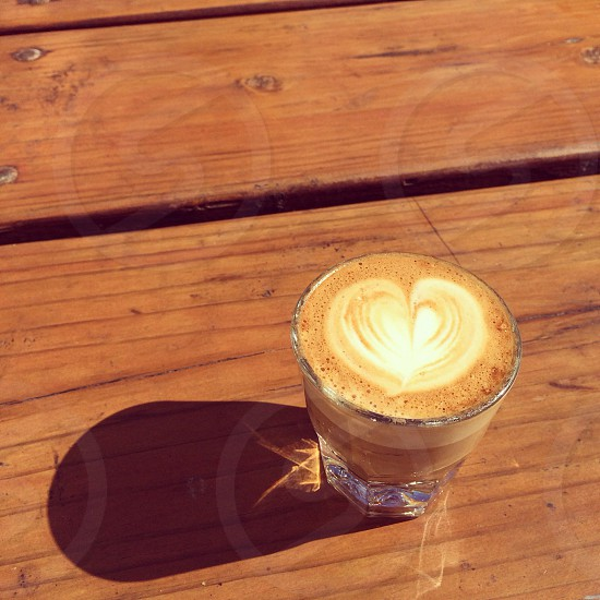 coffee in glass on brown wooden table photo