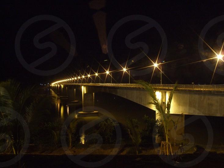 bridge night dark light river strong photo