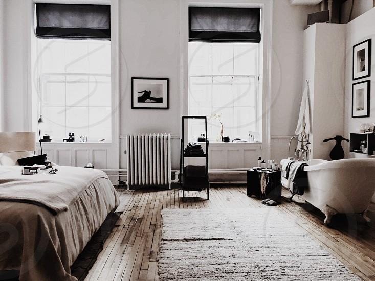 white bedroom with open windows photo