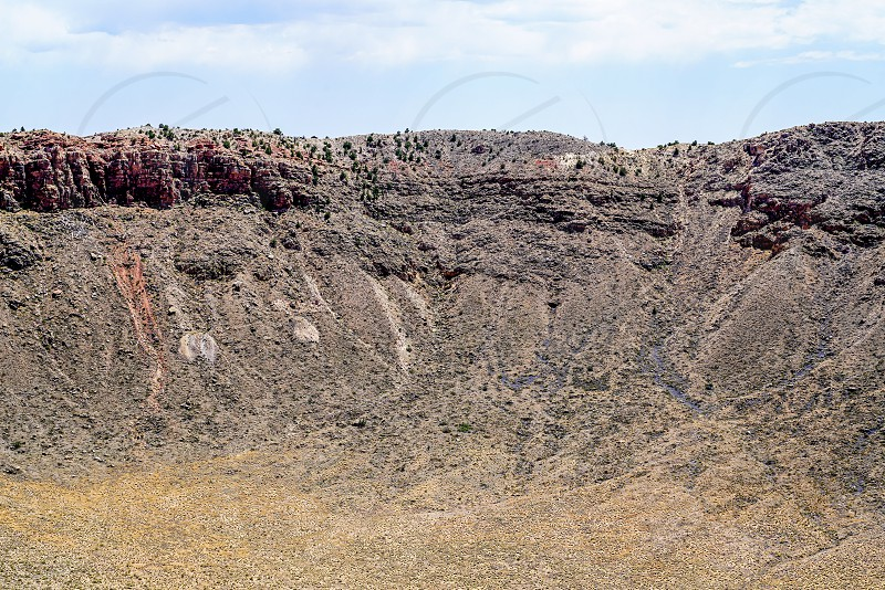 The landscape of Arizona was changed forever when a Meteor fell from the sky and impacted the ground and made a crater almost a mile wide with the rim of the crater 148 ft above the surrounding desert. photo