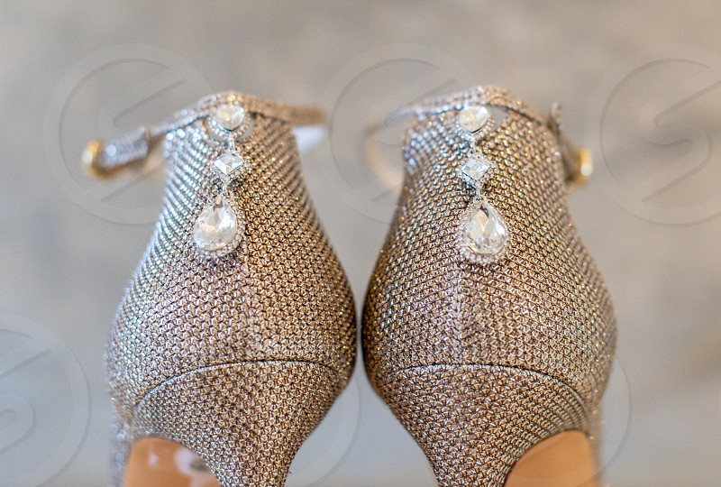 Brides stiletto silver shoes with pearls photo