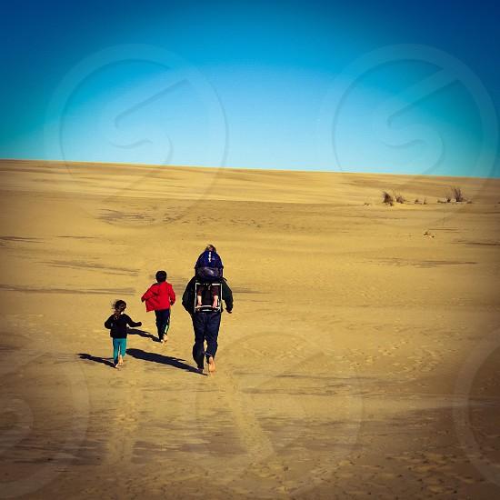 Sand dunes family hike trekking nature beach children adventure summer photo