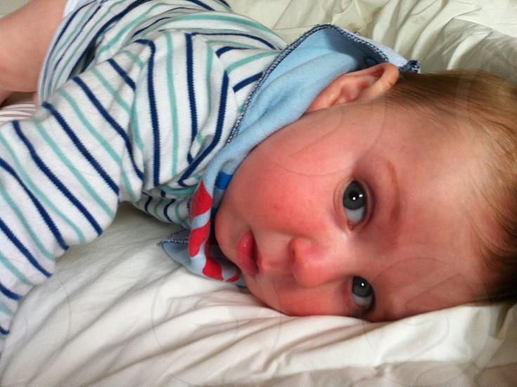 baby lying on bed photo