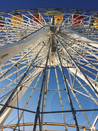 White ferris wheel against blue sky photo