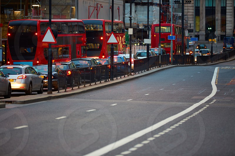 London financial district traffic at sunset Square Mile England photo