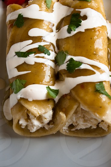 chicken enchiladas with green sauce and crema photo