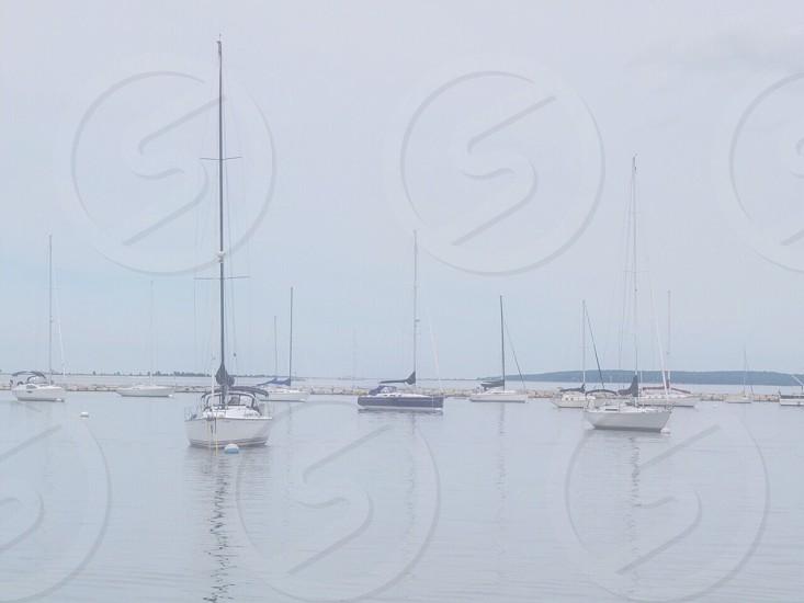 white boat on sea photo