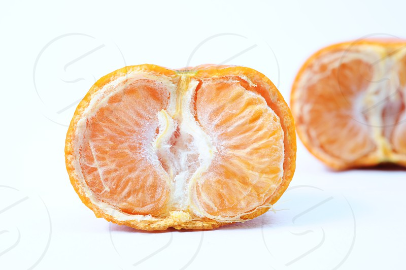 Fresh half cut orange one sliced orange behind it isolated in white background photo