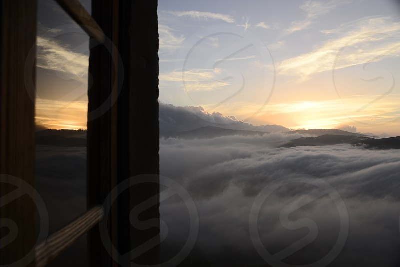 Sunset from the window of the castle of Montecuccolo autumn 2014 #sunset #italy #window #fog #clouds  photo