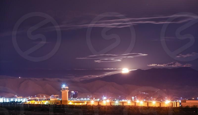 nightskylong exposureairportmountainmountainslightdarkcitycloudsmoonlandscapesceneryscenic photo