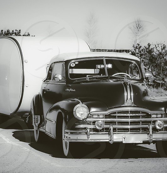 Old car in black and white photo