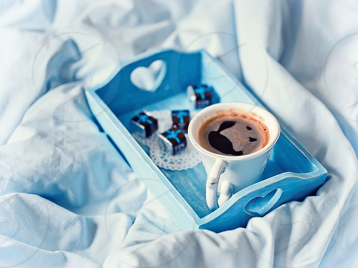 coffee time in a bed in blue color photo