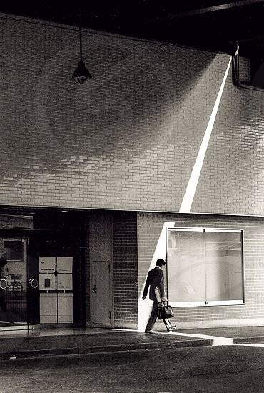 JapanTokyoShimbashisalarymancommutershaft of lightblack and white photo