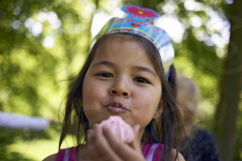 Close up of a cute young girl eating sweets photo
