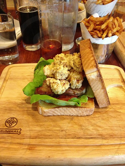 sandwich on top of a brown wooden board photo