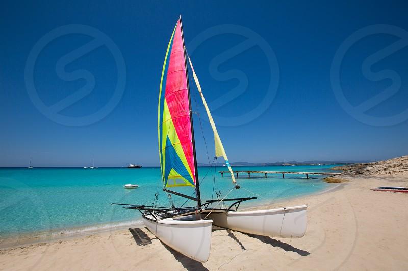 Catamaran sailboat in Illetes beach of Formentera at Balearic Islands photo