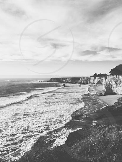 black and white photo of a beach photo