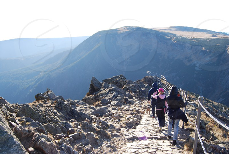 Group of people walk down the path from Sniezka mountain in Karpacz photo