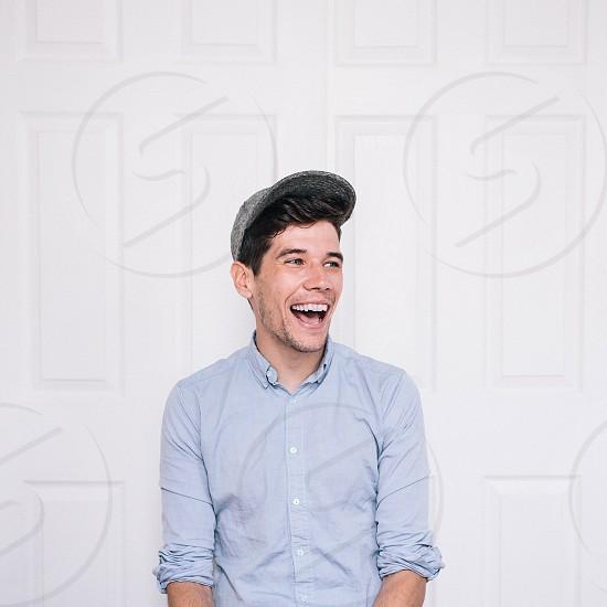 men's light blue button down shirt photo