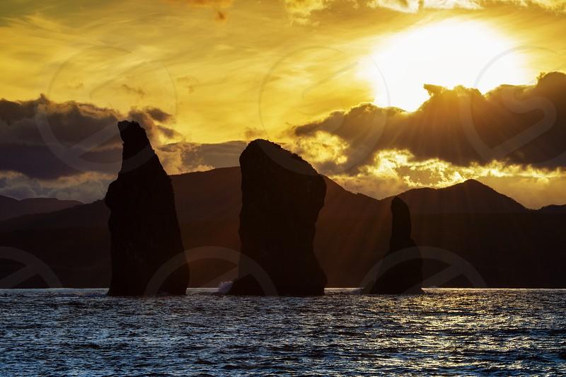 Kamchatka Peninsula scenery seascape at sunset: view of beautiful islands Three Brothers Rocks in Avachinskaya Bay (Avacha Bay). Eurasia Russian Far East Kamchatka Region Pacific Ocean. photo