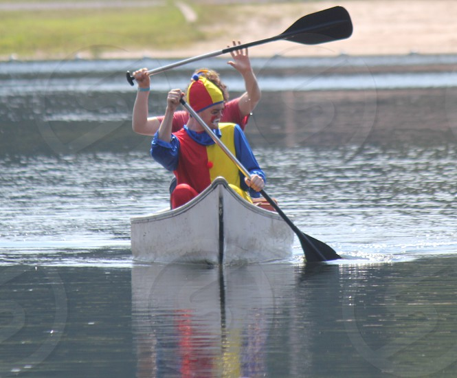 A clown in a canoe photo
